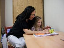 Speech Language Pathologist Kim Minero (L) Helps child practice speech sounds